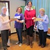 Codsall members, Kath Hughes and Flo Rogers handed over £600 cheques to Laura Owen from The National Children's Autistic Society and Amy Kilpatrick from the Local Motor Neurone Disease Association.