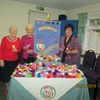 Green Lane Guild knitted little hats for smoothie bottles for Age Concern National Appeal.