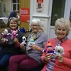 Here are Portchester evening ladies with some of the comic relief dolls they are selling.